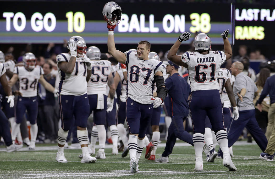 New England Patriots' Rob Gronkowski (87) celebrates with teammates after the NFL Super Bowl 53 football game against the Los Angeles Rams, Sunday, Feb. 3, 2019, in Atlanta. The Patriots won 13-3. ...