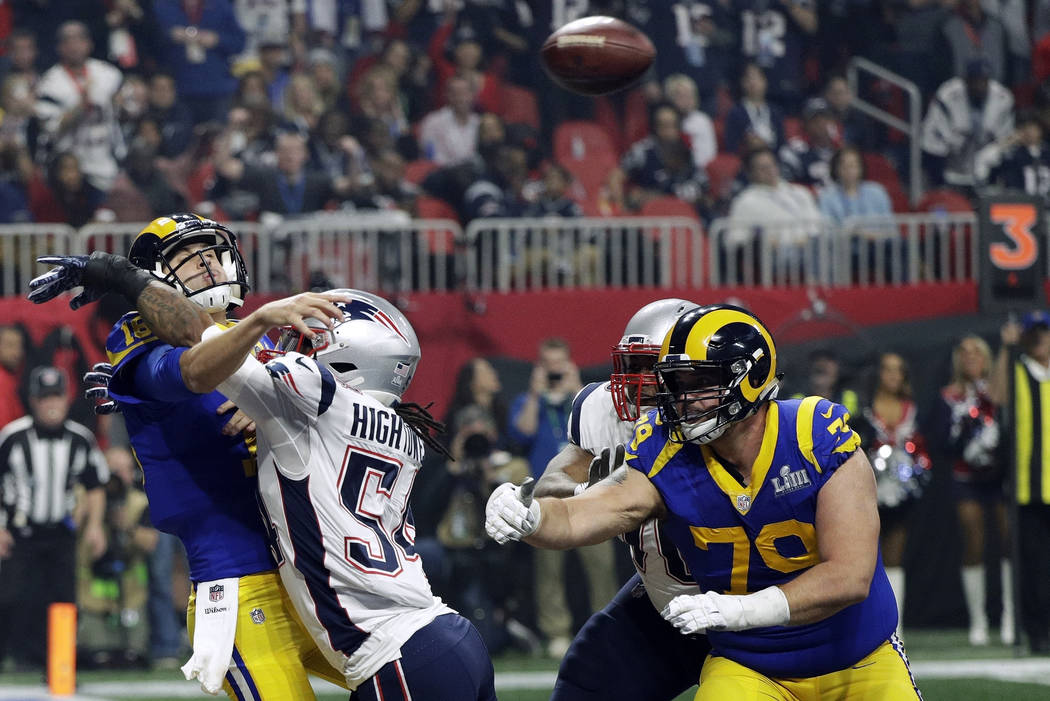New England Patriots' Dont'a Hightower (54) hits Los Angeles Rams' Jared Goff, left, as he throws a pass during the second half of the NFL Super Bowl 53 football game Sunday, Feb. 3, 2019, in Atla ...