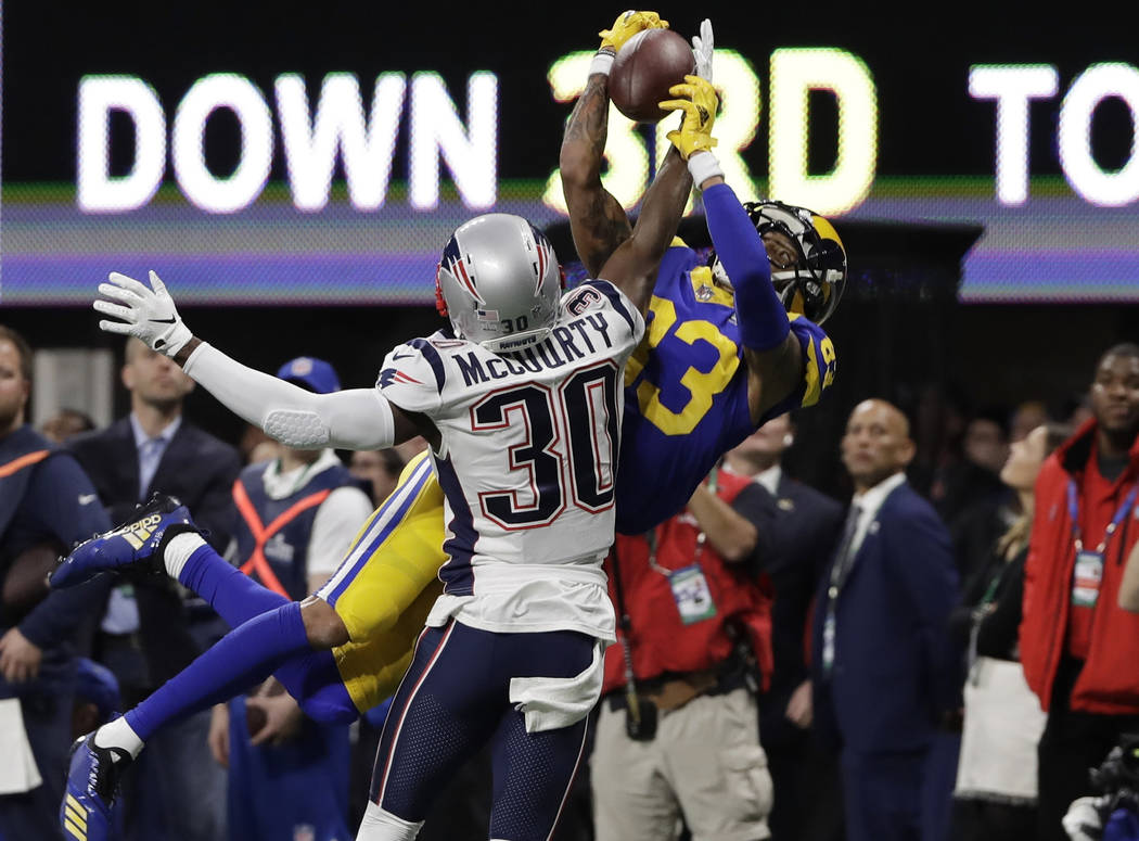 New England Patriots' Jason McCourty (30) breaks up pass intended Los Angeles Rams' Josh Reynolds (83), during the first half of the NFL Super Bowl 53 football game Sunday, Feb. 3, 2019, in Atlant ...
