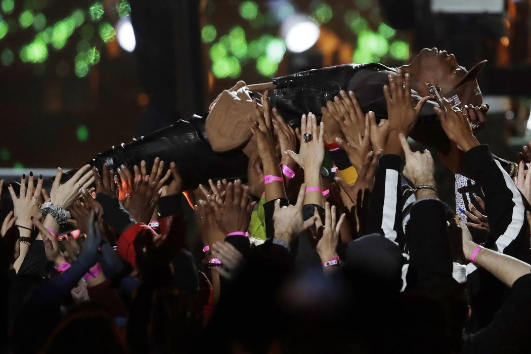 Travis Scott is carried by the crowd during halftime show of the NFL Super Bowl 53 football game between the Los Angeles Rams and the New England Patriots Sunday, Feb. 3, 2019, in Atlanta. (AP Pho ...