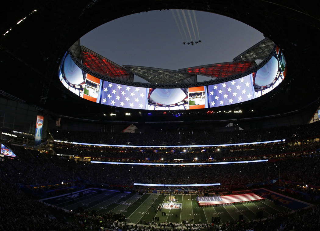 Gladys Knight sings the national anthem as the U.S. Air Force Thunderbirds fly over Mercedes-Benz Stadium before the NFL Super Bowl 53 football game between the Los Angeles Rams and the New Englan ...