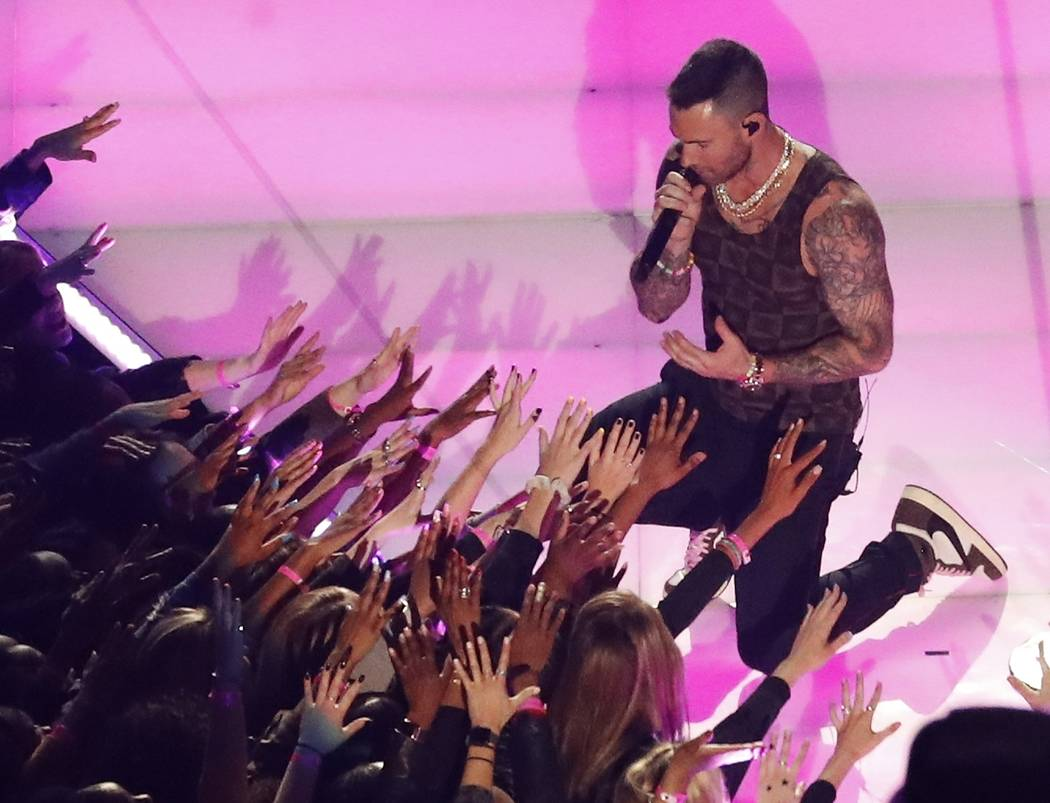 Adam Levine of Maroon 5 performs during the halftime show at the NFL Super Bowl 53 football game between the Los Angeles Rams and the New England Patriots, Sunday, Feb. 3, 2019, in Atlanta. (AP Ph ...