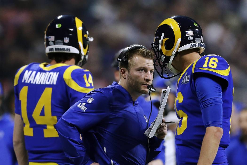 Los Angeles Rams head coach Sean McVay, center, speaks to Jared Goff (16) on the sideline during the second half of the NFL Super Bowl 53 football game against the New England Patriots, Sunday, Fe ...
