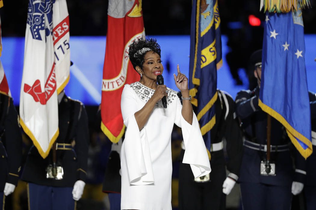 Gladys Knight sings the national anthem before the NFL Super Bowl 53 football game between the Los Angeles Rams and the New England Patriots Sunday, Feb. 3, 2019, in Atlanta. (AP Photo/David J. Ph ...