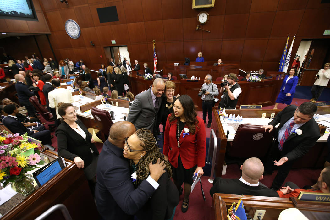 Assembly Speaker Jason Frierson, D-Las Vegas, hugs Assemblywoman Dina Neal, D-North Las Vegas, as female lawmakers walk the chamber in the Legislative Building in Carson City on the first day of t ...