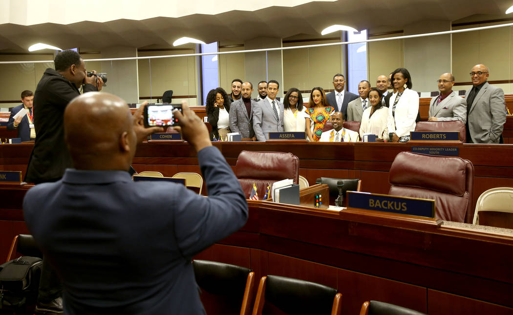Assemblyman Alexander Assefa, D-Las Vegas, seated, poses with his family in the Legislative Building in Carson City on the first day of the 80th session of the Nevada Legislature Monday, Feb. 4, 2 ...