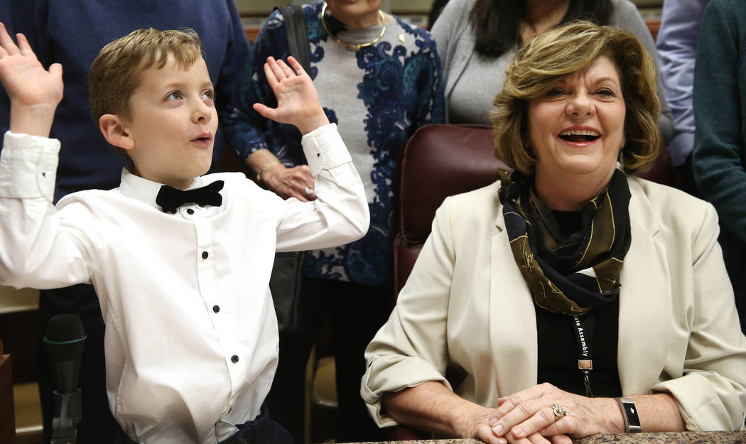 """Connor Clack, 7, does the """"mind-blown"""" gesture after his grandmother, Assemblywoman Connie Munk, D-Las Vegas, told him that she was making history in the first-ever female majority Legis ..."""