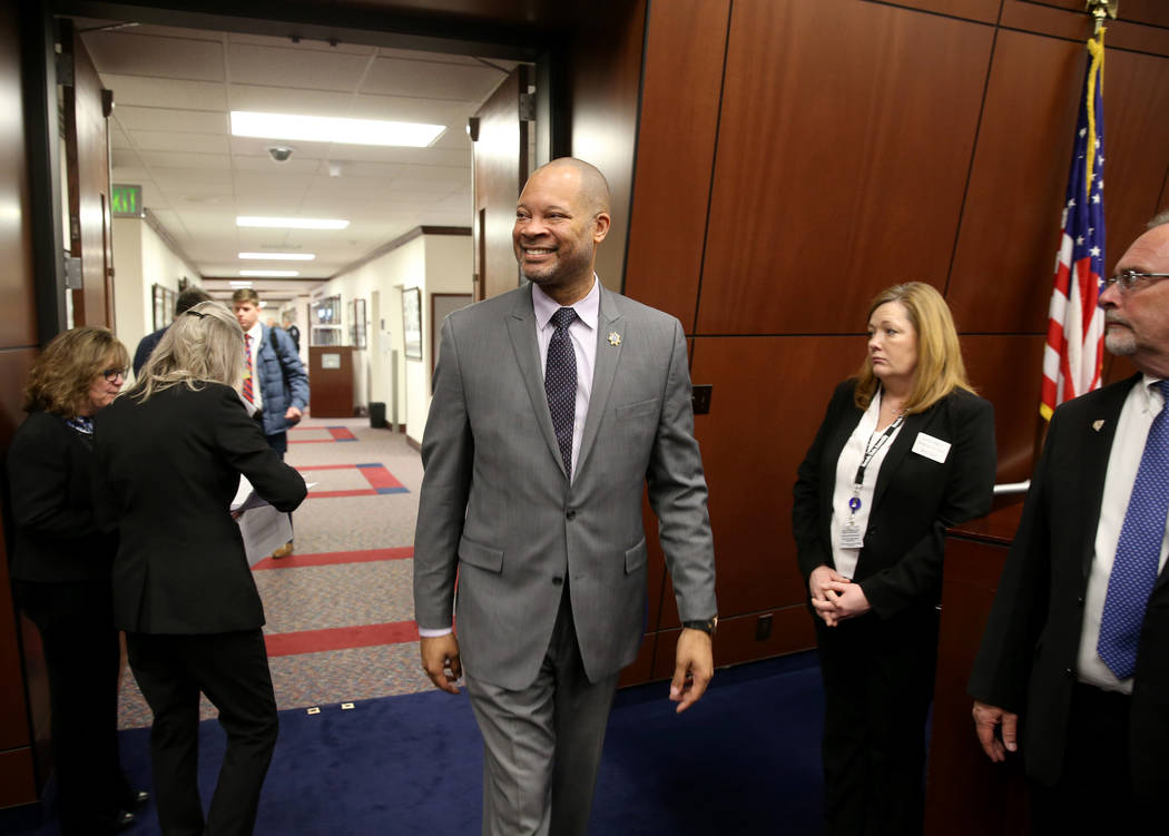 Attorney General Aaron Ford walks into the Assembly chamber in the Legislative Building in Carson City on the first day of the 80th session of the Nevada Legislature Monday, Feb. 4, 2019. (K.M. Ca ...
