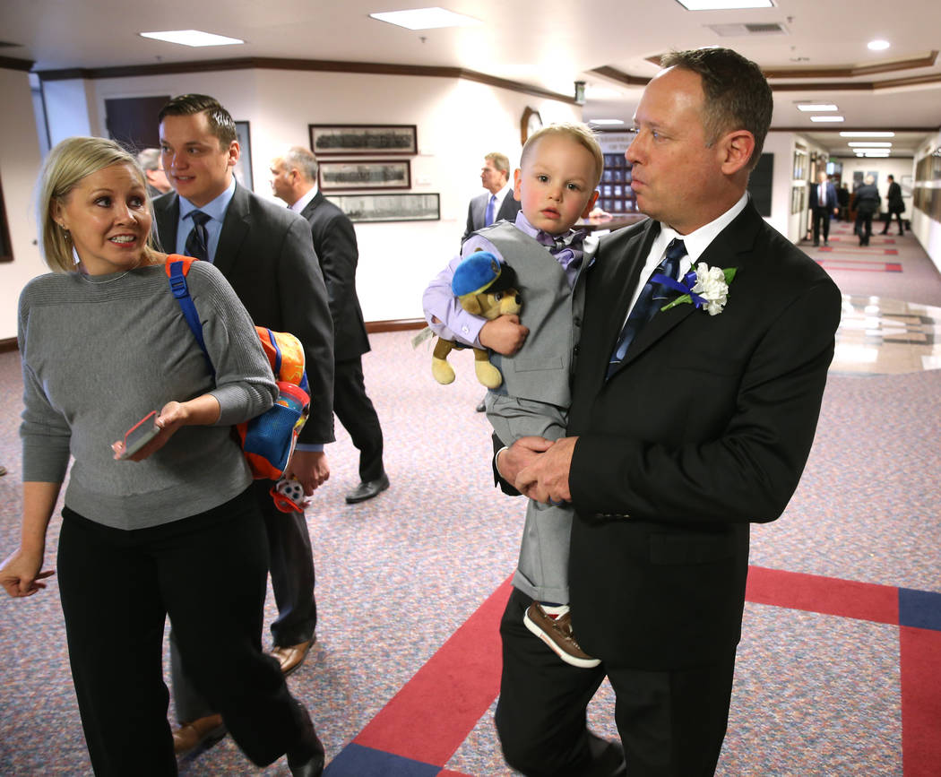 Assemblyman Michael Sprinkle, D-Sparks, carries his grandson Matthew Sprinkle, 2, as his wife Kristi Sprinkle looks on in the Legislative Building in Carson City on the first day of the 80th sessi ...