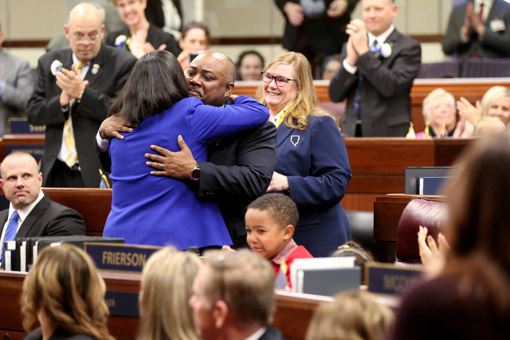 Speaker Jason Frierson, D-Las Vegas, hugs Assemblywoman Rochelle Nguyen, D-Las Vegas, after being named speaker the Legislative Building in Carson City on the first day of the 80th session of the ...