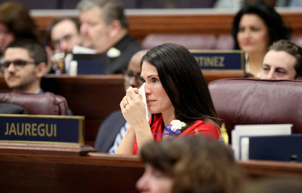Assemblywoman Sandra Jauregui wipes tears after speaking about making history as the first female majority legislature in the country during a floor session in the Legislative Building in Carson C ...
