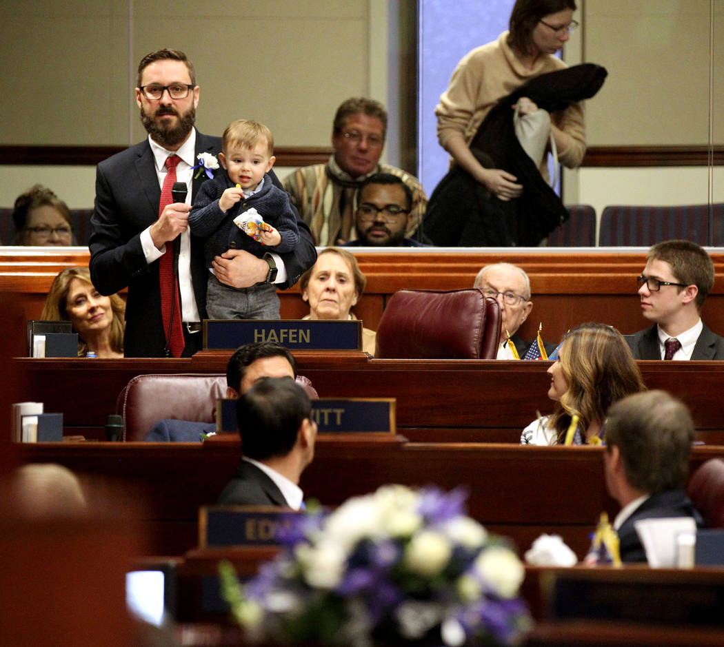 Assemblyman Gregory Hafen, R-Pahrump, introduces his family, including his son Harrison, 1, in the Legislative Building in Carson City on the first day of the 80th session of the Nevada Legislatur ...