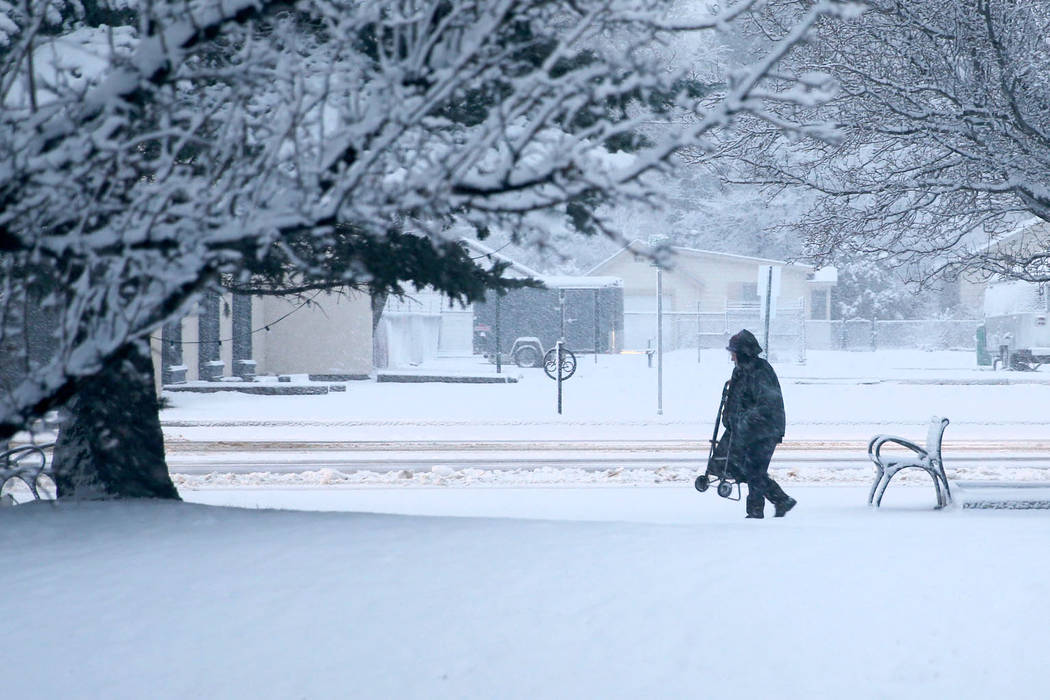 People work their way through snow in front of the Legislative Building in Carson City on the first day of the 80th session of the Nevada Legislature Monday, Feb. 4, 2019. (K.M. Cannon/Las Vegas R ...