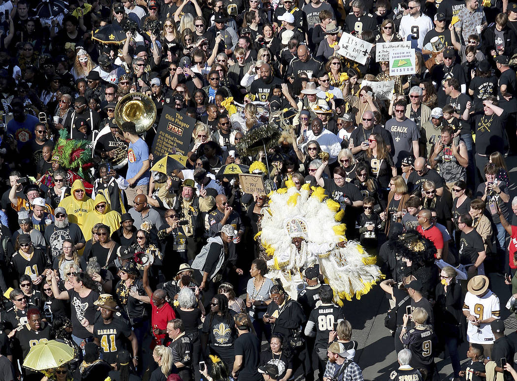 Who Dats fill North Peters Street during the Blackout and Gold Second Line parade in New Orleans to protest the no call that likely cost the Saints a spot in today's Super Bowl on Sunday, Feb. 3, ...