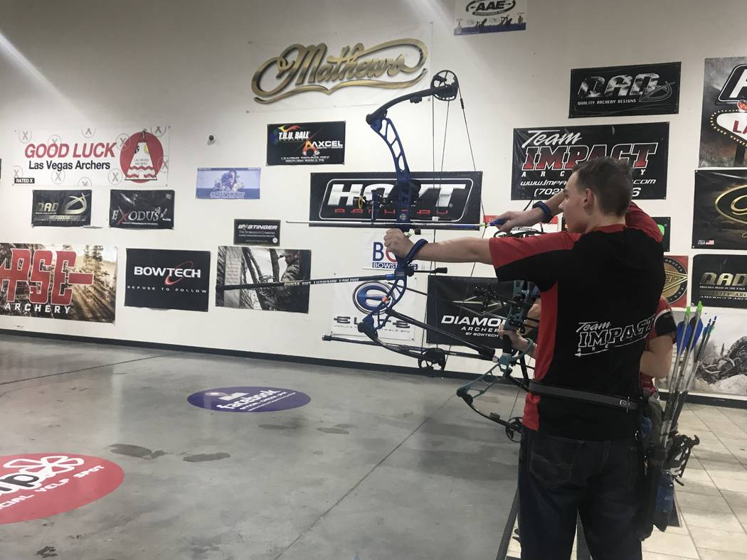 Ryan Boring shoots an arrow at Impact Archery on Friday, Feb. 1. (Rachel Spacek/Las Vegas Review-Journal @RachelSpacek)