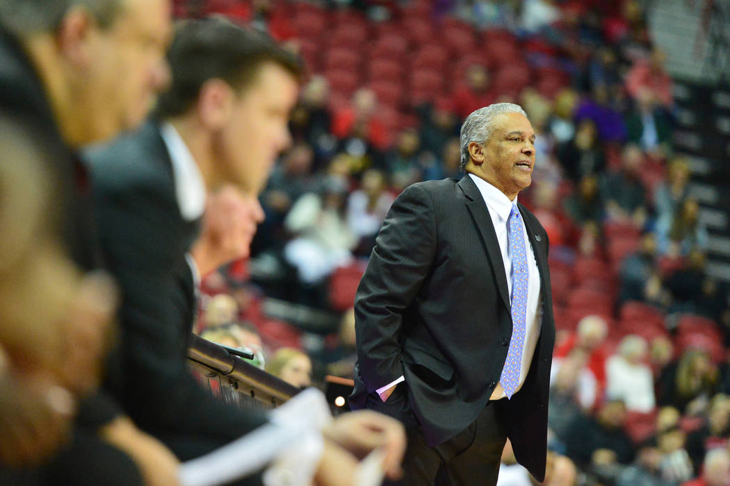 UNLV Rebels head coach Marvin Menzies talks to his players during the second half of the UNLV Rebels and the New Mexico Lobos NCAA basketball game at the Thomas & Mack Center in Las Vegas on Tuesd ...