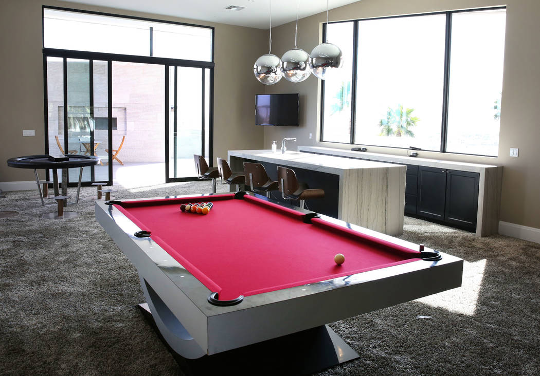 The game room at the mansion of developer Jim Rhodes is seen on Friday, Feb. 1, 2019, in Spanish Hills community in Las Vegas. Rhodes has listed his mansion for almost $30 million. (Bizuayehu Tesf ...