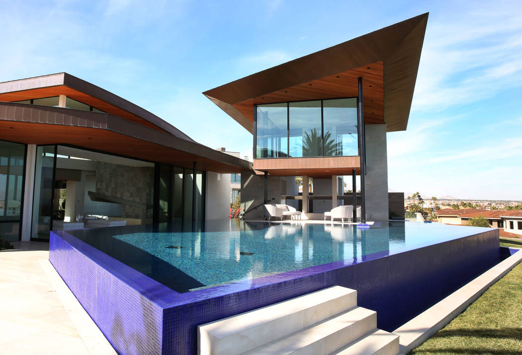 A swimming pool with Zen room, right top, and the master bedroom, left, are seen at the home of developer Jim Rhodes on Friday, Feb. 1, 2019, in Spanish Hills community in Las Vegas. Rhodes has li ...