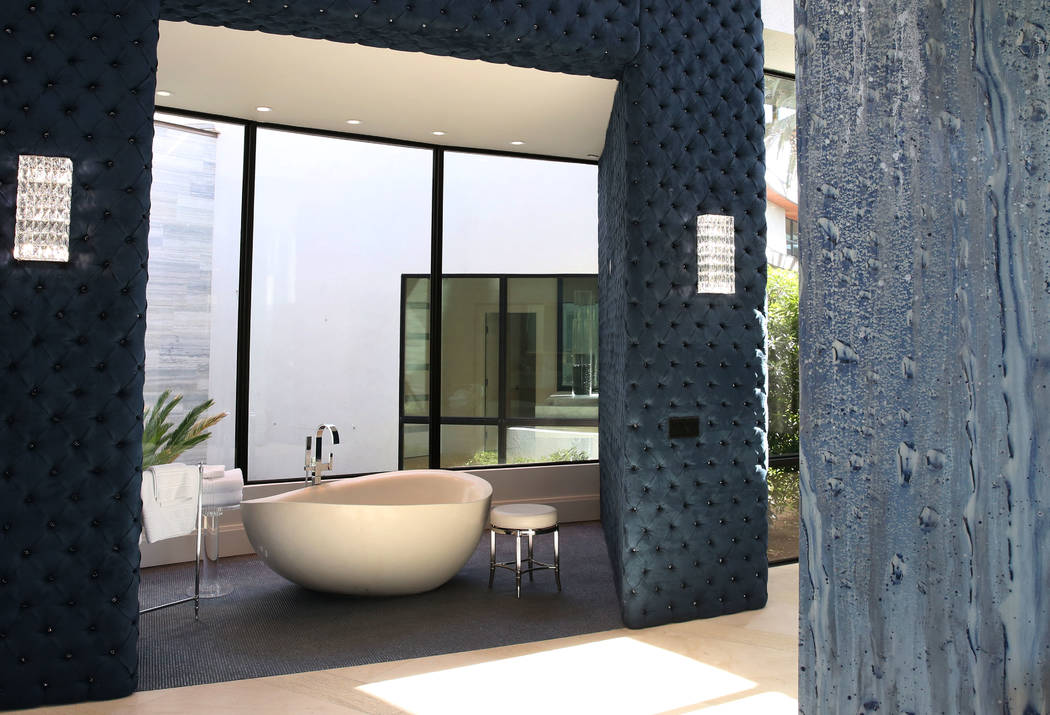 An open modern bathroom at the mansion of developer Jim Rhodes is seen on Friday, Feb. 1, 2019, in Spanish Hills community in Las Vegas. Rhodes has listed his mansion for almost $30 million. (Bizu ...