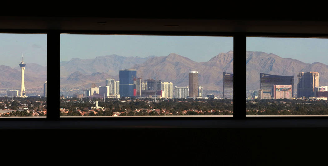 The Las Vegas Strip is seen through family room windows on Friday, Feb. 1, 2019 at the mansion of developer Jim Rhodes in the Spanish Hills community in Las Vegas. Rhodes has listed his mansion fo ...