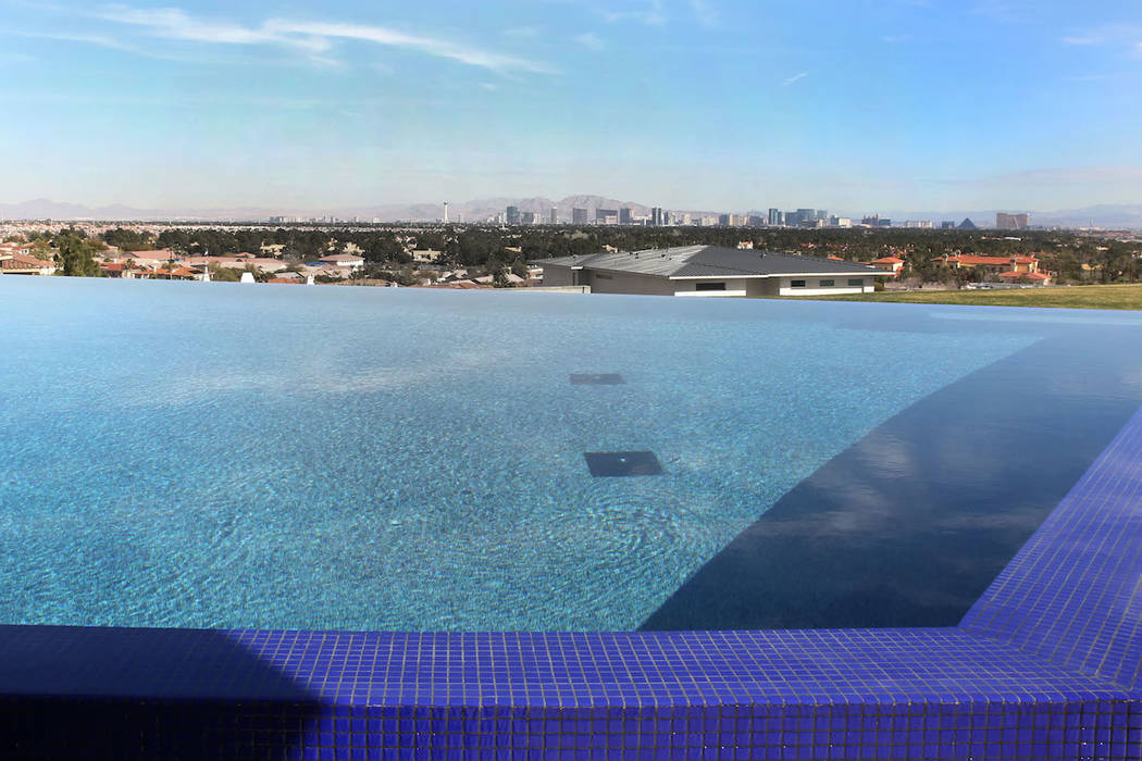 A swimming pool with view of the Las Vegas Strip at the mansion of Jim Rhodes, a developer, photographed on Friday, Feb. 1, 2019, in Spanish Hills community in Las Vegas. Rhodes has listed his man ...