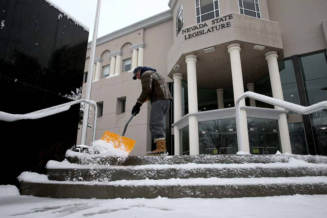 Randy Bird shovels snow in front of the Legislative Building in Carson City on the first day of the 80th session of the Nevada Legislature Monday, Feb. 4, 2019. (K.M. Cannon/Las Vegas Review-Journ ...