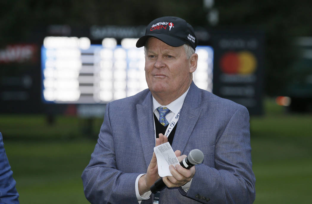 FILE - In this Oct. 16, 2016, file photo, Johnny Miller stands on the 18th green of the Silverado Resort North Course during the trophy presentation of the Safeway Open PGA golf tournament, in Nap ...