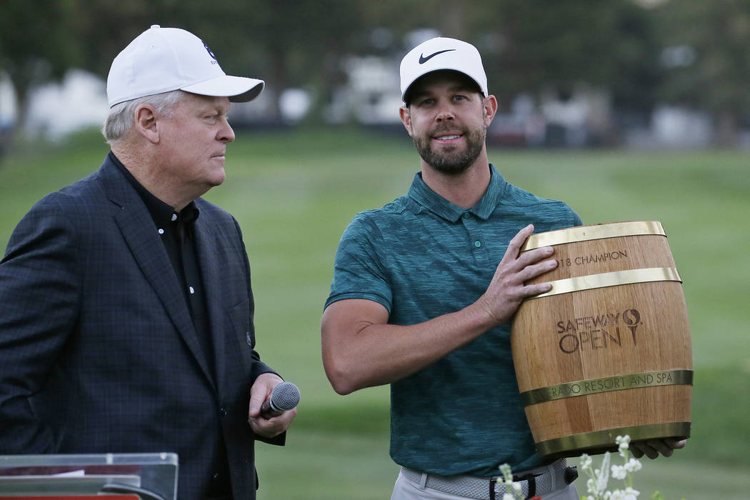 Kevin Tway holds his trophy on the 18th green of the Silverado Resort North Course after winning the Safeway Open PGA golf tournament Sunday, Oct. 7, 2018, in Napa, Calif. Tway won the tournament ...