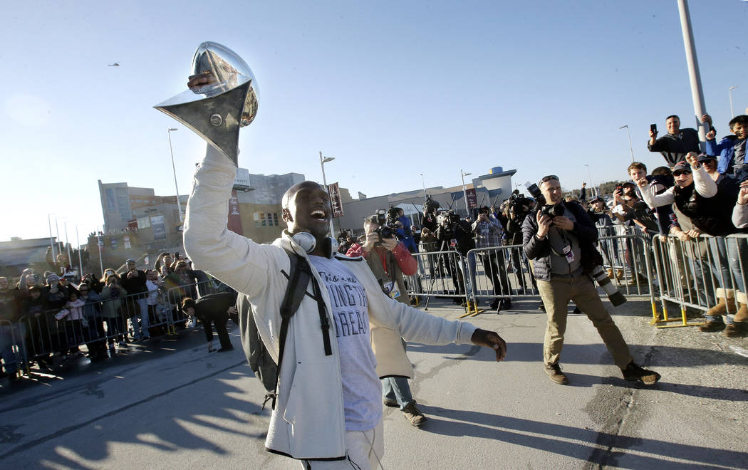 New England Patriots cornerback Jason McCourty holds the Super Bowl trophy for fans following the football teams arrival at Gillette Stadium, Monday, Feb. 4, 2019, in Foxborough, Mass., after defe ...