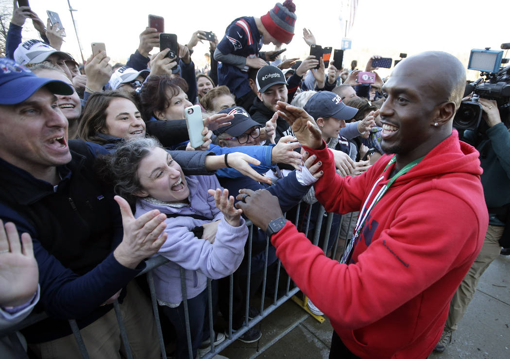 New England Patriots free safety Devin McCourty, right, greets fans following the football teams arrival at Gillette Stadium, Monday, Feb. 4, 2019, in Foxborough, Mass, after defeating the Los Ang ...