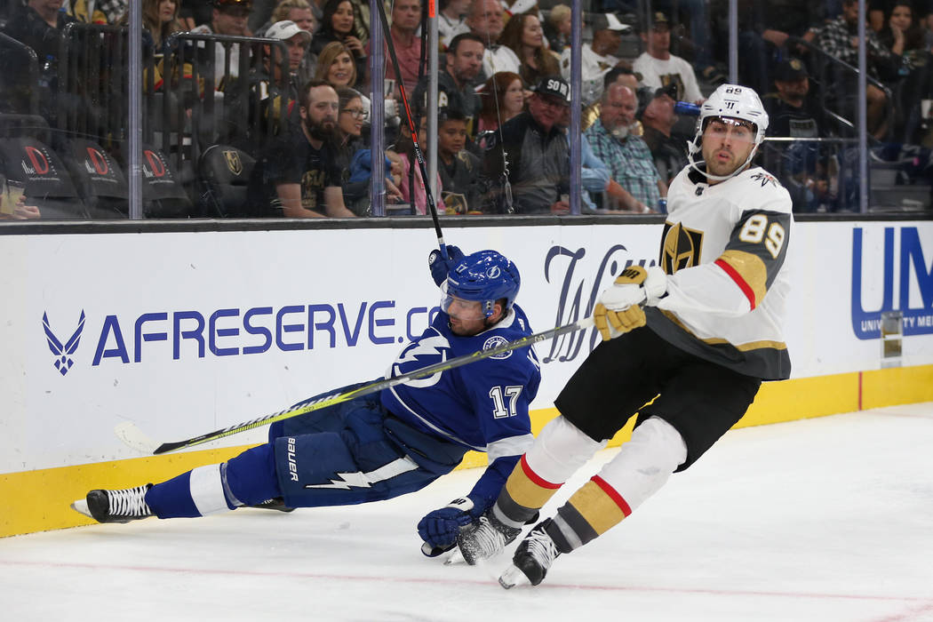 Tampa Bay Lightning left wing Alex Killorn (17) takes a fall while defending against Vegas Golden Knights right wing Alex Tuch (89) during the third period of an NHL game at T-Mobile Arena in Las ...