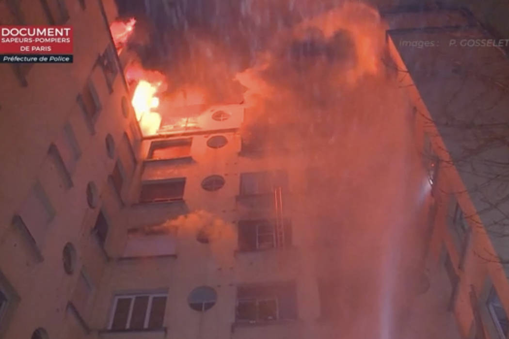 In this image taken from video released by the Paris Fire Dept., fire fills the top floors of an apartment building, Tuesday, Feb. 5, 2019, in Paris, France. A fire in a Paris apartment building h ...