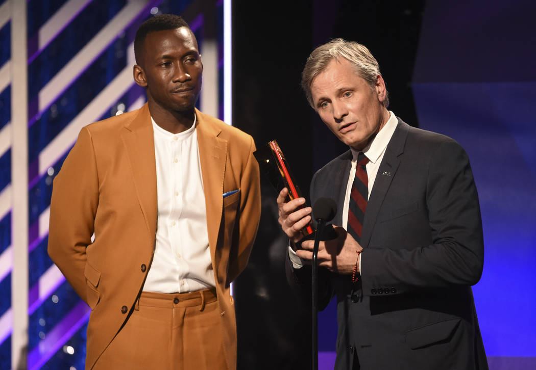 """CORRECTS MONTH TO FEBRUARY INSTEAD OF JANUARY - Mahershala Ali, left, presents the Best Actor award to Viggo Mortensen for """"Green Book"""" during the 18th Annual Movies For Grownups Awards ..."""