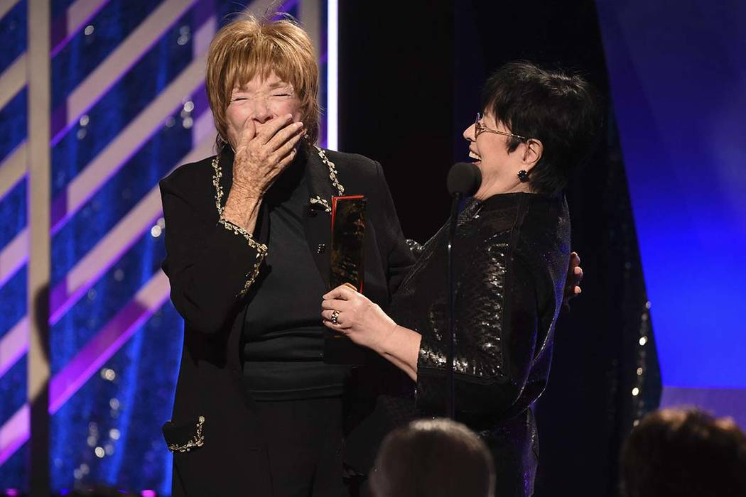 Shirley MacLaine, left, accepts the Career Achievement award from Kathy Bates during the 18th Annual Movies For Grownups Awards at Beverly Wilshire Hotel on Monday, Feb. 4, 2019, in Beverly Hills, ...