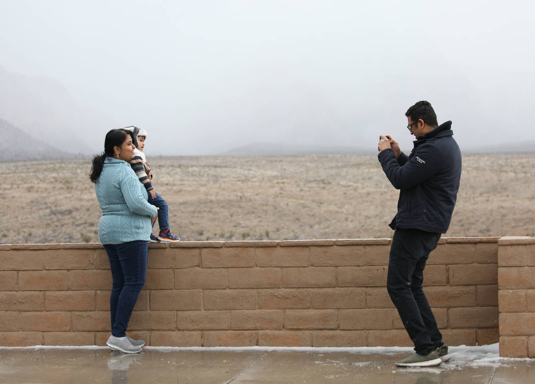 Shiv Bonman of India takes a picture of his wife, Uma, and his son, Atharva, 2, at Red Rock Canyon on Tuesday, Feb. 5, 2019, in Las Vegas. (Bizuayehu Tesfaye/Las Vegas Review-Journal) @bizutesfaye