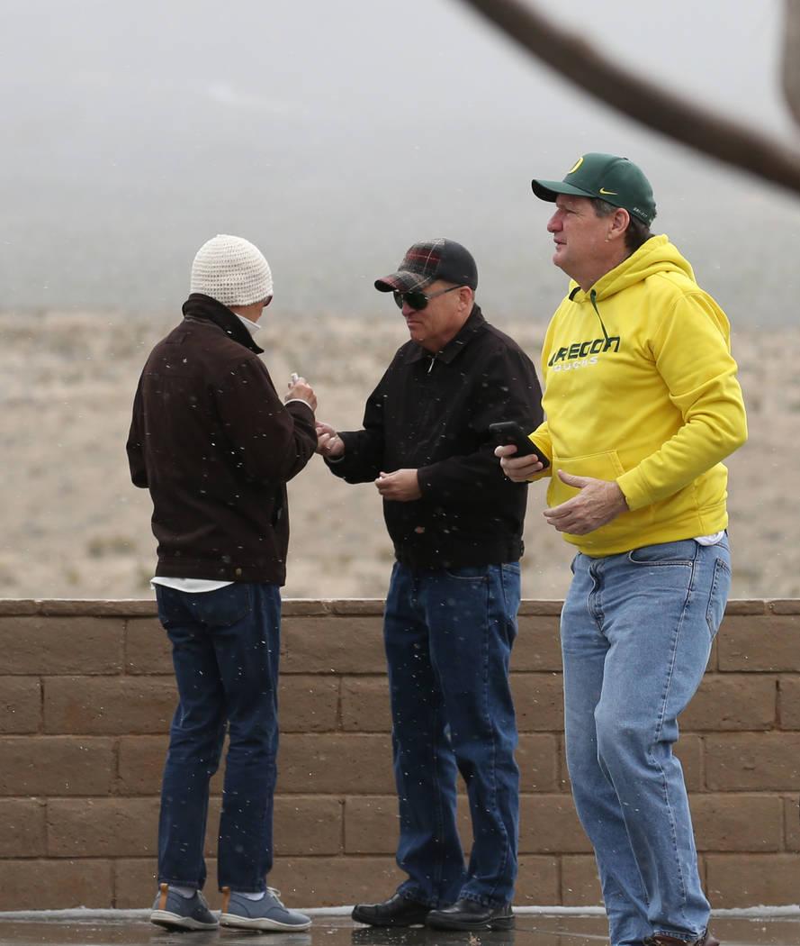 Visitors stand in the hail and freezing rain near Red Rock Canyon on Tuesday, Feb. 5, 2019, in Las Vegas. (Bizuayehu Tesfaye/Las Vegas Review-Journal) @bizutesfaye