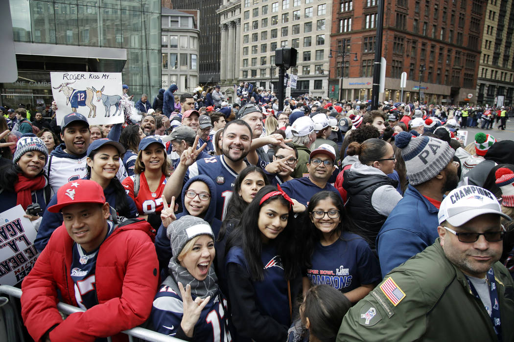 Fans gather near Boston City Hall, Tuesday, Feb. 5, 2019, to watch the New England Patriots football team victory parade through the streets of Boston to celebrate their win over the Los Angeles R ...