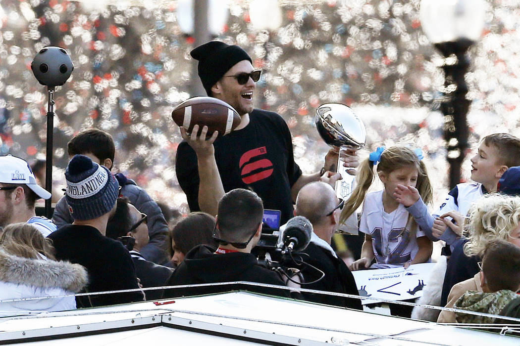 New England Patriots' Tom Brady rides a duck boat during the Patriots parade through downtown Boston, Tuesday, Feb. 5, 2019, to celebrate their win over the Los Angeles Rams in Sunday's NFL Super ...