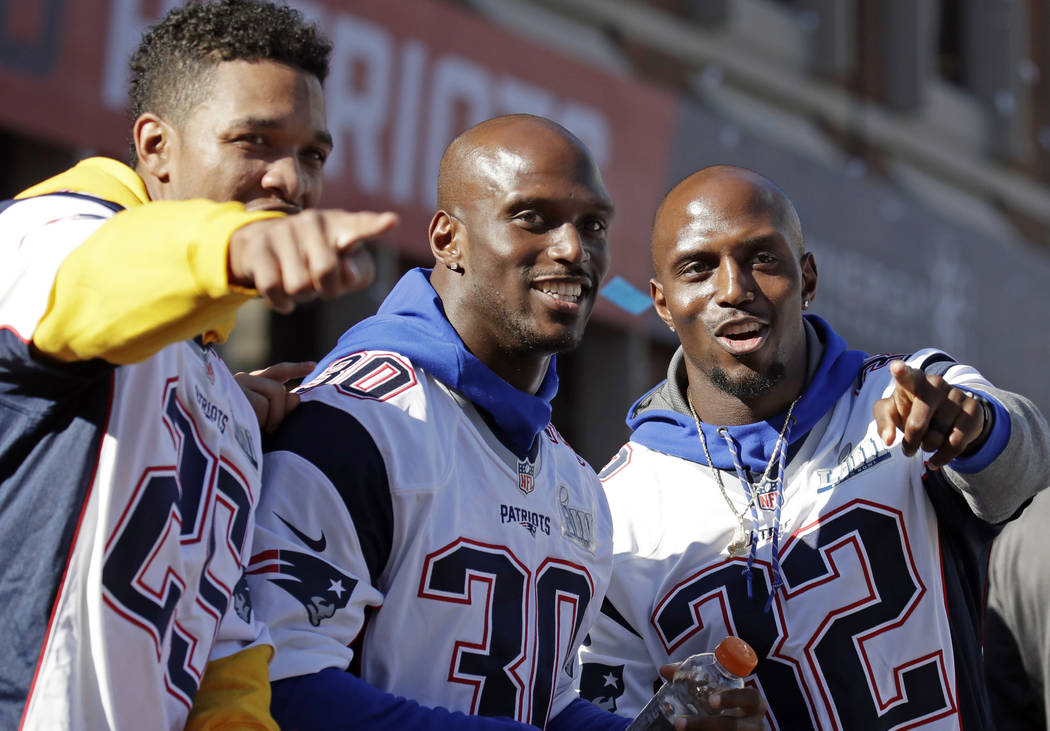 New England Patriots (l-r) Eric Rowe, Jason McCourty and Devin McCourty react to fans during their victory parade through downtown Boston, Tuesday, Feb. 5, 2019, to celebrate their win over the Lo ...