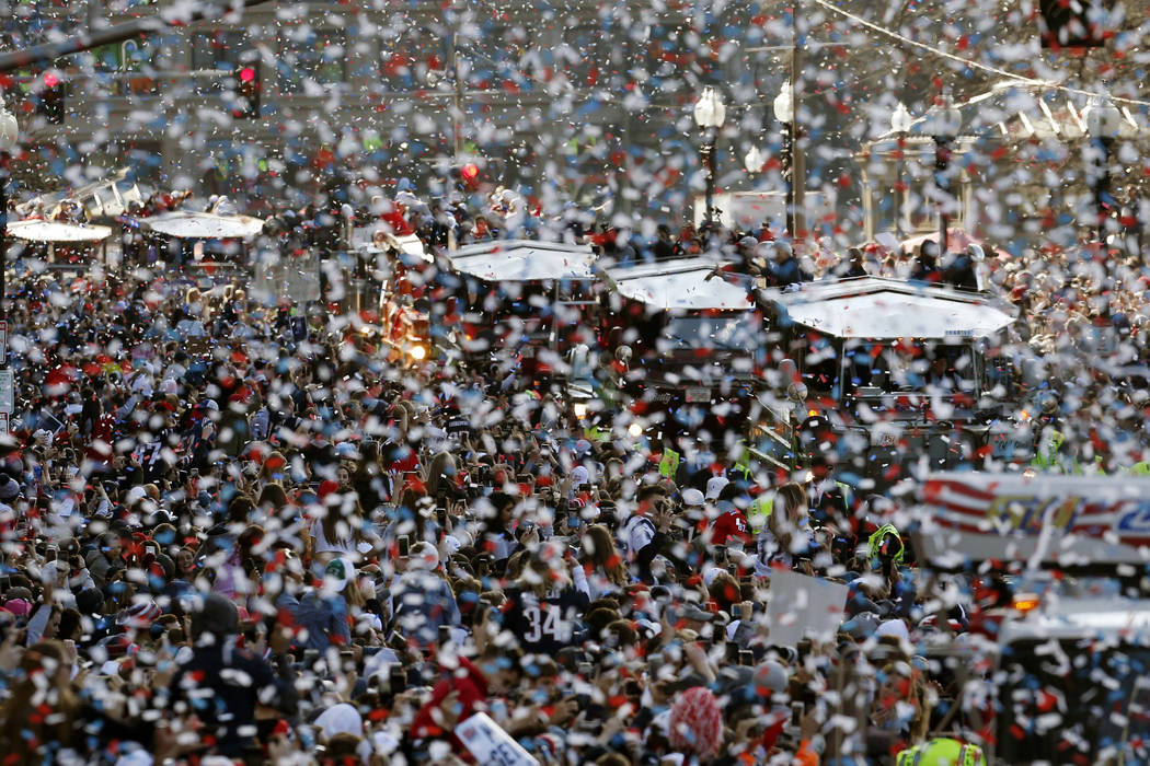 The New England Patriots parade makes its way through downtown Boston, Tuesday, Feb. 5, 2019, to celebrate their win over the Los Angeles Rams in Sunday's NFL Super Bowl 53 football game in Atlant ...