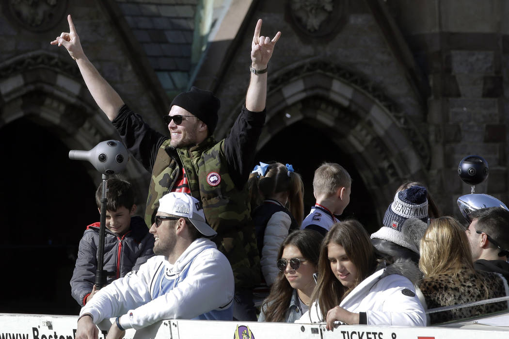New England Patriots' Tom Brady celebrates as the team parades through downtown Boston, Tuesday, Feb. 5, 2019, to celebrate their win over the Los Angeles Rams in Sunday's NFL Super Bowl 53 footba ...