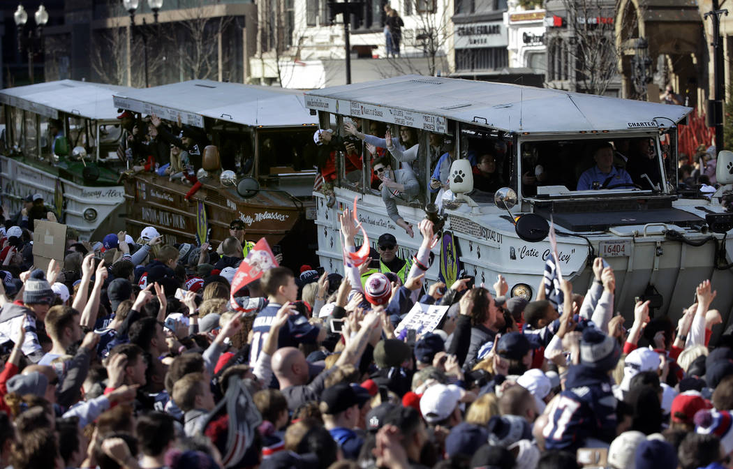 The New England Patriots parade through downtown Boston on duck boats, Tuesday, Feb. 5, 2019, to celebrate their win over the Los Angeles Rams in Sunday's NFL Super Bowl 53 football game in Atlant ...