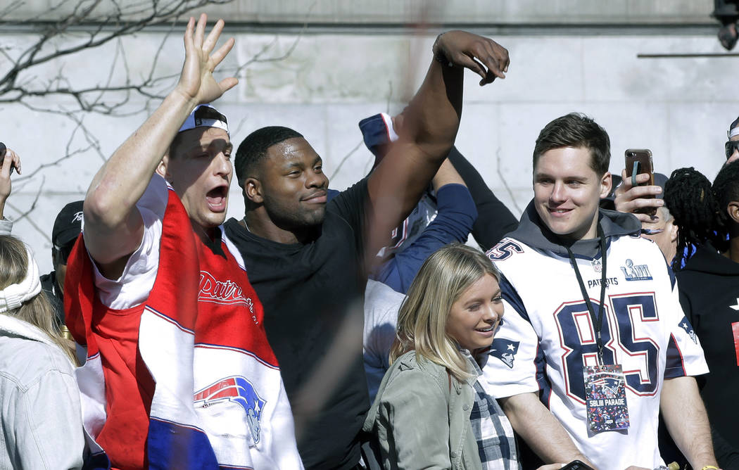 New England Patriots Rob Gronkowski, left, Dwayne Allen, center, and Ryan Izzo parade through downtown Boston, Tuesday, Feb. 5, 2019, to celebrate their win over the Los Angeles Rams in Sunday's N ...
