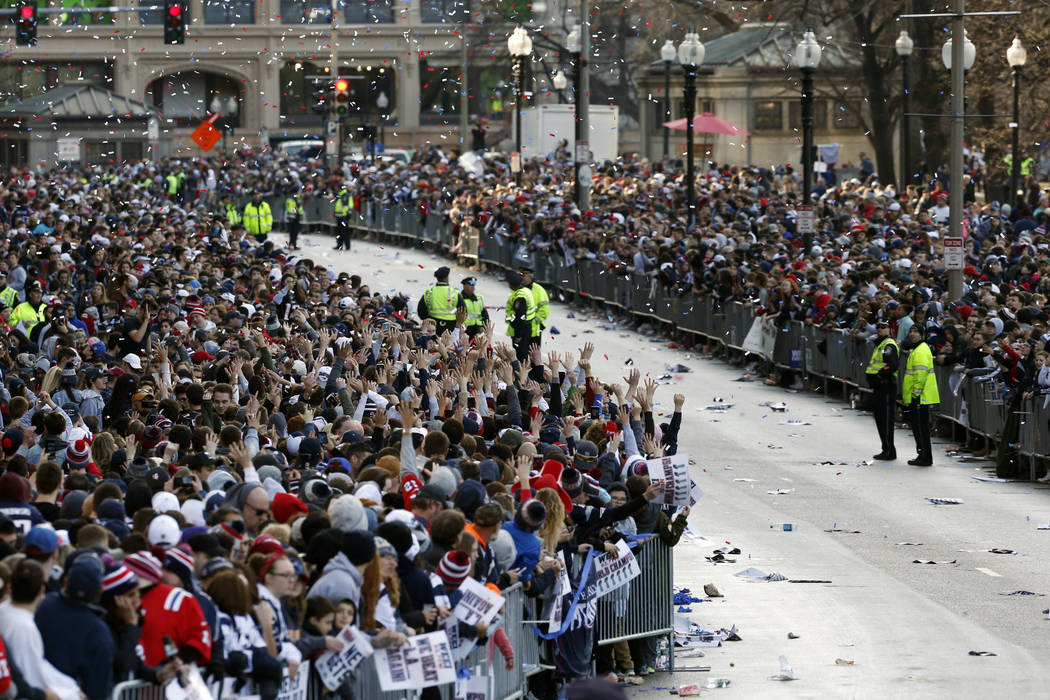 Fans line Tremont Street before the New England Patriots parade through downtown Boston, Tuesday, Feb. 5, 2019, to celebrate their win over the Los Angeles Rams in Sunday's NFL Super Bowl 53 footb ...