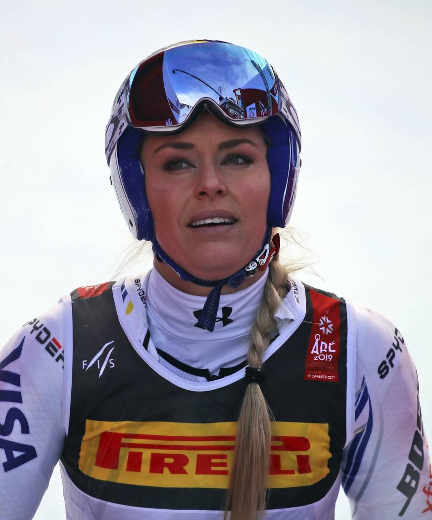 United States' Lindsey Vonn arrives at the finish area after crashing during the women's super G during the alpine ski World Championships, in Are, Sweden, Tuesday, Feb. 5, 2019. (AP Photo/Marco T ...