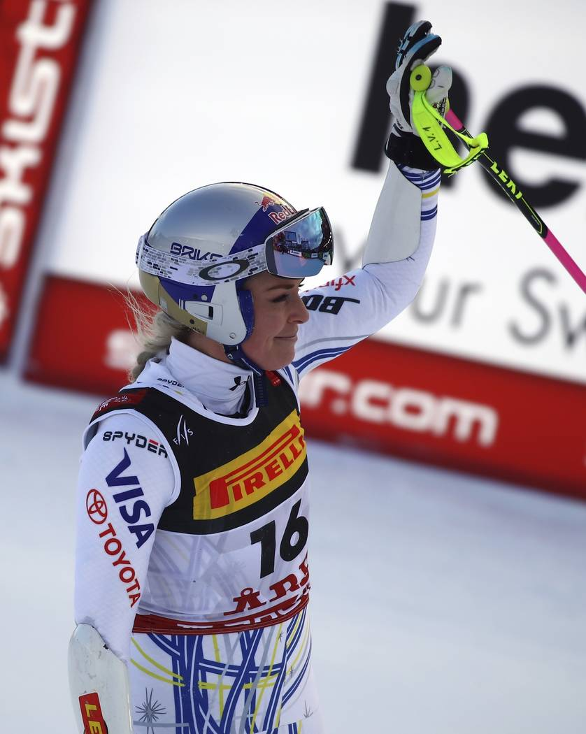United States' Lindsey Vonn waves as she arrives at the finish area after crashing during the women's super G during the alpine ski World Championships, in Are, Sweden, Tuesday, Feb. 5, 2019. (AP ...