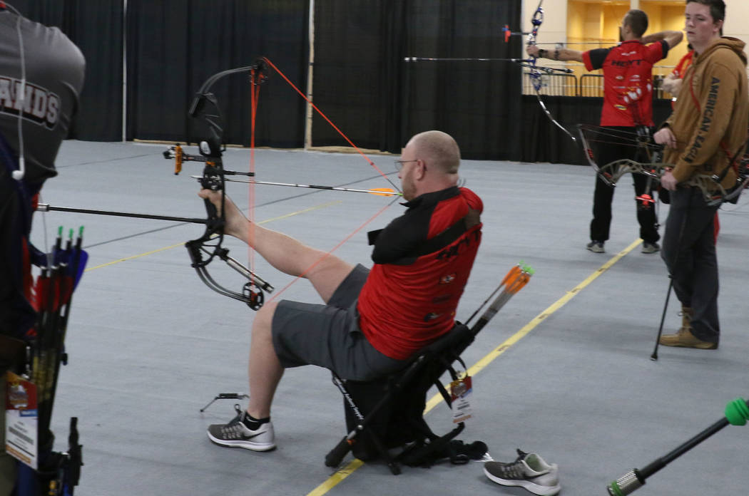 Archer Matt Stutzman aims at target using his feet during practice ahead of the Big Shot archery tournament at South Point on Friday, Feb. 8, 2019, in Las Vegas. (Bizuayehu Tesfaye/Las Vegas Revie ...