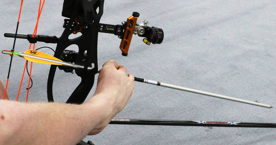 Archer Matt Stutzman loads his bow using his feet during practice ahead of the Big Shot archery tournament at South Point on Friday, Feb. 8, 2019, in Las Vegas. (Bizuayehu Tesfaye/Las Vegas Review ...