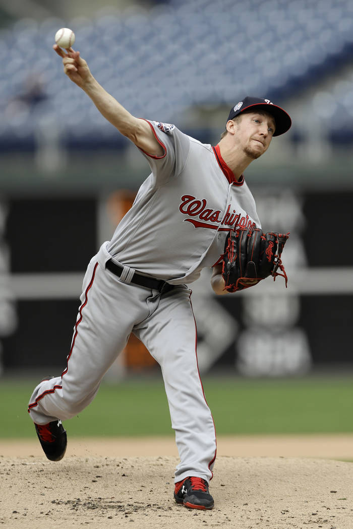 Washington Nationals' Erick Fedde pitches during the first inning of the first game of a baseball doubleheader against the Philadelphia Phillies, Tuesday, Sept. 11, 2018, in Philadelphia. (AP Phot ...