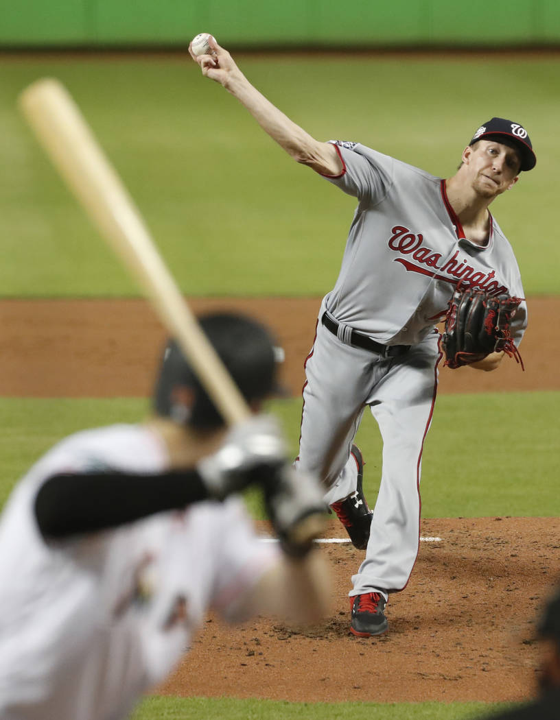 Washington Nationals' Erick Fedde pitches to Miami Marlins' Brian Anderson during the first inning of a baseball game, Monday, Sept. 17, 2018, in Miami. (AP Photo/Wilfredo Lee)